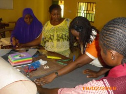 Olga teaching craft making to deaf teachers and students